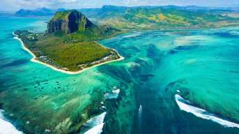 island mauritius sea blue green forestation motorboat aerial view drone photography